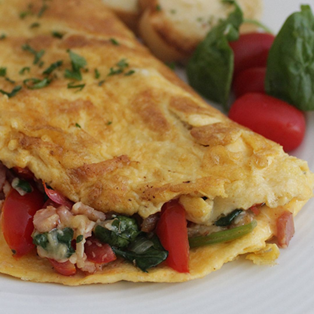 Bacon spinach cheese omelette - yum!
